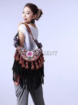 Ethnic embroidered bag with tassel decoration