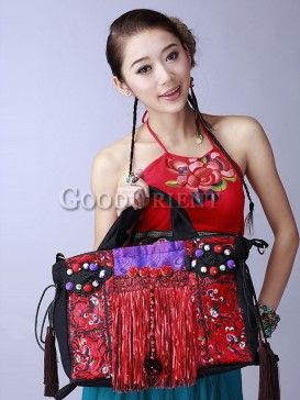 Ethnic bag with dragon embroidery and flower decoration