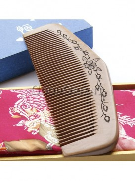 Moon shaped comb with flower carving