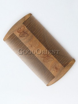 Comb with butterfly carving
