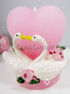 Wedding candles with heart shape of swan design