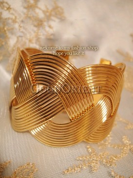 Golden stylistic bracelet